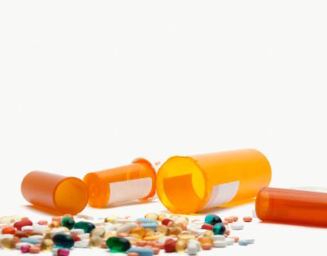 Spilled pills and pill bottles